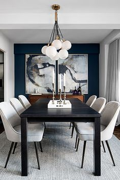 A Blue accent wall emphasizes the Horchow two piece Percussion framed art, focal point of the dining area