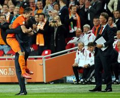Dutch soccer history is made! Against Hongary Robin van Persie scores his 40th goal for the Netherlands and equals the 40 made by record holder Patrick Kluivert (the guy he's hugging). A half hour later Robin scores number 41. And iron coach Louis van Gaal... is smiling?