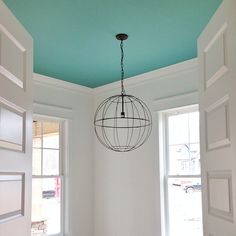 White walls, turquoise ceiling, light fixture. Love.