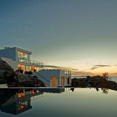 Spanish photographer Eugeni Pons is a master of his craft and captured a #magic moment of this #breathtaking #house in the #perfect #sunset. Enjoy more #beautiful #architecture on #homify  #home #design #contemporary #cube #pool #terrace #ocean #sea #view #modernliving #modernarchitecture #cubichouse #white #mountains