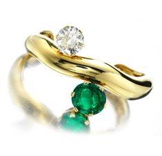 An Emerald and Diamond Cuff, by Suzanne Belperron, circa 1965. Via FD Gallery, www.fd-inspired.com
