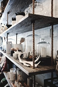 Things Friday – Beachy Farmhouse Tour Brilliant shop interior via Studio Number Reclaimed wood shelves hang from rope.Brilliant shop interior via Studio Number Reclaimed wood shelves hang from rope. Shop Interiors, Rustic Interiors, Interior Pastel, Diy Hanging Shelves, Floating Shelves, Regal Design, Rustic Design, Decoration Bedroom, Shop Fittings