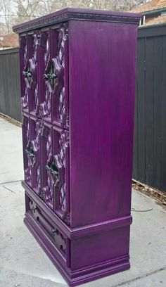Purple stained wood armoire