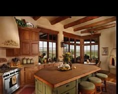 Love this kitchen...so rustic and cozy, but my practical side is saying where is the storage?