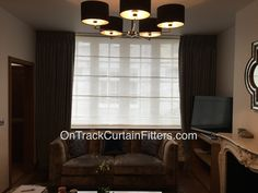 Kirsch regular track, supplied and fitted with double duty runners as standard top fixed with tall drop. Beautifully made Roman blind and curtains supplied by Lena Jones Designs, hung and dressed by us.