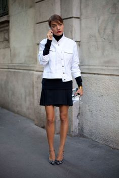 Leopard heels add punch to her black and white ensemble.