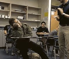 After falling asleep in class, a student wakes up to his teacher clapping in front of him and he does the same.