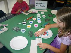 Science Crafts 2014 - Painting outer space sun catchers. July 26, 2014.