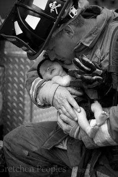 Firefighter themed infant photoshoot.  Daddy with baby girl- Copyright Gretchen Peoples Photography