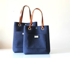 20% DISCOUNT UNTIL OCTOBER THE 31st, use the coupon code: OCTOBER SALE- Please, send me a message if you have problem with using the coupon, I will reserve you a private listing! Medium Tote bag - Blue coloured Felt Tote Bag which is handmade from 3mm Felt and High Quality Italian Leather. The Leather is Vegetable tanned and handcut. The bag, thanks to the metal clip inside, has two different shapes: larger or smaller on the top, suitable for every occasion in your everyday life. Because ...