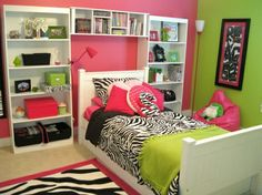 For Shais room... hot pink, lime green and zebra tween room...I love the bookcases built around the bed.