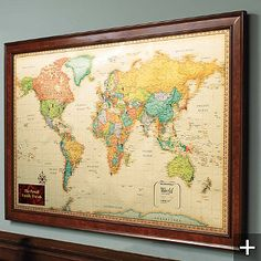It is magnetized! We just hung it in the living room and I rushed back to Frontgate to order the U.S. map as well. Beautiful!
