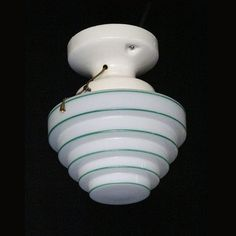 Milk glass with original green strips around each step on the globe. Great accent color for a vintage kitchen or bathroom light. Antique white porcelain fitter which can handle up to 75 watts. The pull Vintage Light Fixtures, Vintage Lighting, Ceiling Fixtures, Kitchen Lighting Fixtures, Art Deco Lamps, Modern Ceiling Light, Wall Colors, Drum Pendant Lighting, Modern Sconce Lighting