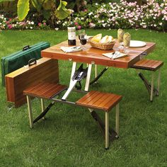 This picnic table set comes in an attractive brown wood stain, and even has a zippered protective case made from sturdy canvas. You don't need any kind of tools to set it up, so anyone can use it! The table and seats are made from wood, and the frame is an aluminum alloy to keep it lightweight but strong. Each seat can handle up to 240 pounds, so the picnic table set is sturdy and will last you for years. $134.99