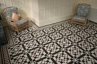 Complex black and white checkered tiled floor