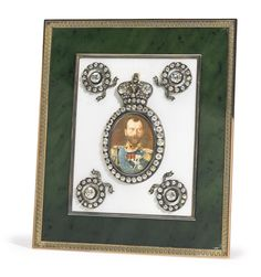 A RARE AND IMPORTANT FABERGÉ JEWELLED GOLD, NEPHRITE AND TRANSLUCENT ENAMEL IMPERIAL PRESENTATION TABLE PORTRAIT, WORKMASTER HENRIK WIGSTRÖM, ST. PETERSBURG; MINIATURE BY VASILII ZUEV, 1909