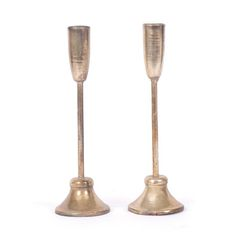 These champagne flute shaped candlesticks are brass with a rustic finish. The brass illuminates beautifully when lit.