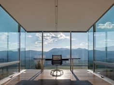 Bohlin Cywinski Jackson designed this modern house with a cantilevered office that features floor-to-ceiling glass windows and views of the mountains.