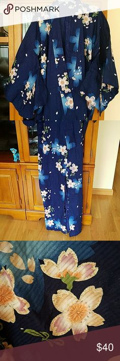 Yukata (cotton robe) Cotton yukata.  Very pretty deep blue flowers that have sprinkles on the edges.  Used and does not cone with a bow.  Size large , but can fit a medium.  Yukata does not need hemming.  Just tuck the waist area into the bow . Other