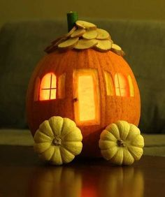 Pumpkin Cottage with clever food decorations. Mini pumpkin wheels, sliced potato shingles and a whole clove for the door knob.