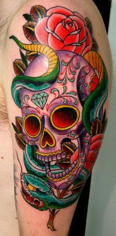 Sugar skull tattoo design with snake and roses