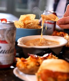 This Beer Cheese Dip only has three ingredients: Budweiser, Sharp Cheddar, and Gruyere. Ya, it's that easy. It's also stupid good.