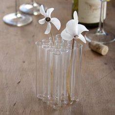 I like this idea of multiple small vases, becoming one. Since I am one, who can never get my bouquets right, this is a highly likeable solution. Maybe by tying a bunch of cylinders together with rope, it will create a 'rustic' vase.