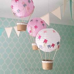 Similar to this, but make paper canoes to hang from the ceiling.