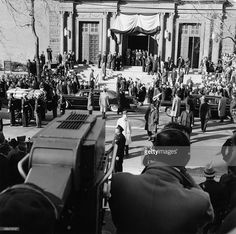 1963-11-25: The casket of President Kennedy, and the Kennedy family in cars during the state funeral of President John F. Kennedy at St. Matthew's Cathedral in Washington D.C.