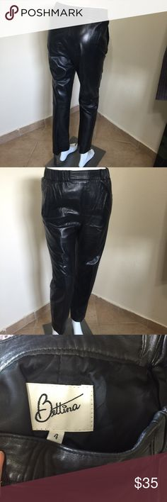 Vintage 80s Leather Sexy Pants Black Bettina S 2 4 Label-Bettina Authentic 80s Vintage Style- Pull on half elastic waist on sides, pegged leg, side slit pockets, large hem if you want to lengthen, fits almost like a jogger, fully lined Size-4 Shown on a 2 mannequin Will fit a 2 or 4 Measurements-W-26 Hip-38 Inseam-28 Leg Rise- 12 Sits at Natural waist- Leg opening-7 Color-Black Fabric-Leather, lined in Polyester Condition-Excellent exterior condition, lightening to lining inside Origin-USA…