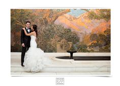 Gorgeous photo of a recent Curtis Center bride and groom in front of the Tiffany mosaic!