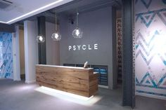 Spin class or night club Psycle blends fitness with dancing it out for one hot mama of a workout is part of Gym interior - With it's clublike approach to spin class, Psycle is London's trendiest fitness studio of the moment Alexa Tucker tried it Yoga Studio Design, Gym Design, Design Ideas, Wall Design, Reception Desk Design, Lobby Reception, Modern Reception Area, Office Reception Area, Reception Ideas