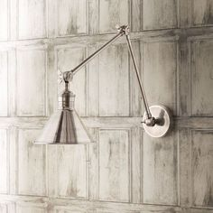Made from pure brass and finished in antique silver, the Stork Adjustable Antique Silver Wall Light would be perfect on either side of a bed or next to an armchair, giving you some extra light for a relaxing reading session. These lights would also look great in a row, leading guests down a corridor or along a kitchen wall to illuminate countertops while you cook.