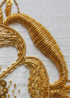 Goldwork detail. Learn the techniques of goldwork with Hand & Lock. Take a look at our online course here: https://www.mastered.com/courses/22 Preorder for £80.