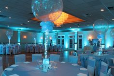 Turquoise Uplighting Turquoise Uplighting with Silver Sparkle Balloon Centerpieces