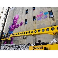 """It's a wrap‼️ Ron @ronenglishart killed it in the blazing sun for @lomanartfest creating a HOT Pink Temper Tot:) Thanks Ron‼️ #ronenglish #thelisaprojectnyc #LoManArtFest #littleitalynyc #mural #muralart #NYC @team_popaganda"