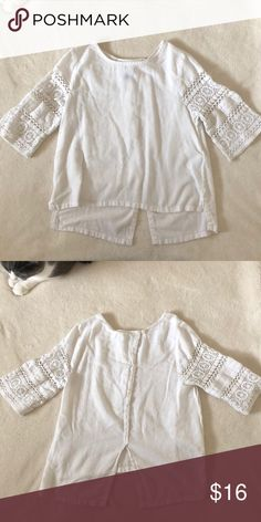 Old Navy Blouse Sweet white 3/4 sleeve top with crochet details on sleeves. High low feature with open slit at back bottom of shirt. Great condition Old Navy Shirts & Tops Blouses