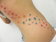 rainbow stars tatoo..Id love this going across my shoulder down my chest:)