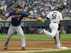 Chicago White Sox's Alex Rios (51) reaches first on a throwing error by Minnesota Twins shortstop Brian Dozier to Joe Mauer, scoring Adam Dunn, during the first inning of a baseball game, Tuesday, July 24, 2012, in Chicago