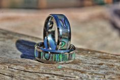 This Titanium ring features an authentic Abalone Shell inlay. Abalone shell is most noted for its unmistakable natural beauty. We have embedded this precious resource within a durable titanium band so