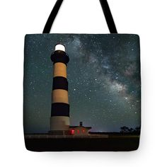 Bodie Lighthouse Milky Way Tote Bag by Norma Brandsberg. The tote bag is machine washable, available in three different sizes, and includes a black strap for easy carrying on your shoulder. All totes are available for worldwide shipping and include a money-back guarantee.