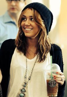 Miley Cyrus looking cozy and casual with her Starbucks