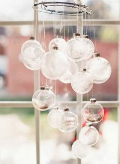 Ornament chandelier with clear glass bulbs filled with feathers, tinsel, and glitter.