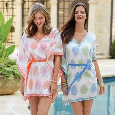 2 colors: blue/green and pink/tangerine. Cotton voile butterfly style cover-up features removable waist tie and contrast print piecing around neckline, sleeve opening and hem. Measures approximately 34' from shoulder to hem. One size fits most.