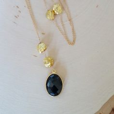 "This unique long necklace features gold plated pyrite nuggets and bezel set faceted black onyx wire wrapped onto 14k goldfilled chain.     Sophisticated Boho chic. Great layering piece but also stand alone fabulously!     Necklace is 36"" in length w/ additional 2"" pendant and 1.5"" extension chain. Spring clasp closure.    Arrives packaged in a gift box. 