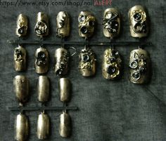 12 fake nails with 3D nail art : steampunk style and 6 plain nails plus glue. €18.00, via Etsy.