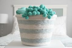 Turn a laundry basket into a pretty striped basket. | 30 Cheap And Brilliant Dollar Store Hacks