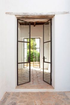Belgian family rescued an Ibiza finca from ruins, restoring it into a magical getaway rental - Belgian Pearls Patio Interior, Interior And Exterior, Casa Petra, Architecture Design, Deco Design, Windows And Doors, Panel Doors, Home Decor Inspiration, French Doors
