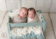 """I had the distinct honor of photographing my very own, brand new nieces this morning. Aren't they gorgeous?!?!   Thank you to Cat of Catherine King Photography for the assist, and to Ute of Ute-Christin Photography for the studio use :)  Adorable """"crib"""" - another great find at Decor!"""
