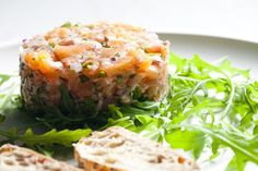 Lomi Lomi Salmon Tartare - Lomi lomi is the Hawaiian phrase for massage. Traditionally you would massage the salmon and other ingredients with your hands but feel free to use a utensil if fishy hands aren't your thing. Spicy Recipes, Salmon Recipes, Fish Recipes, Vegan Recipes, Cooking Recipes, Tartare Recipe, Salmon Tartare, Spicy Salmon, Summer Dishes